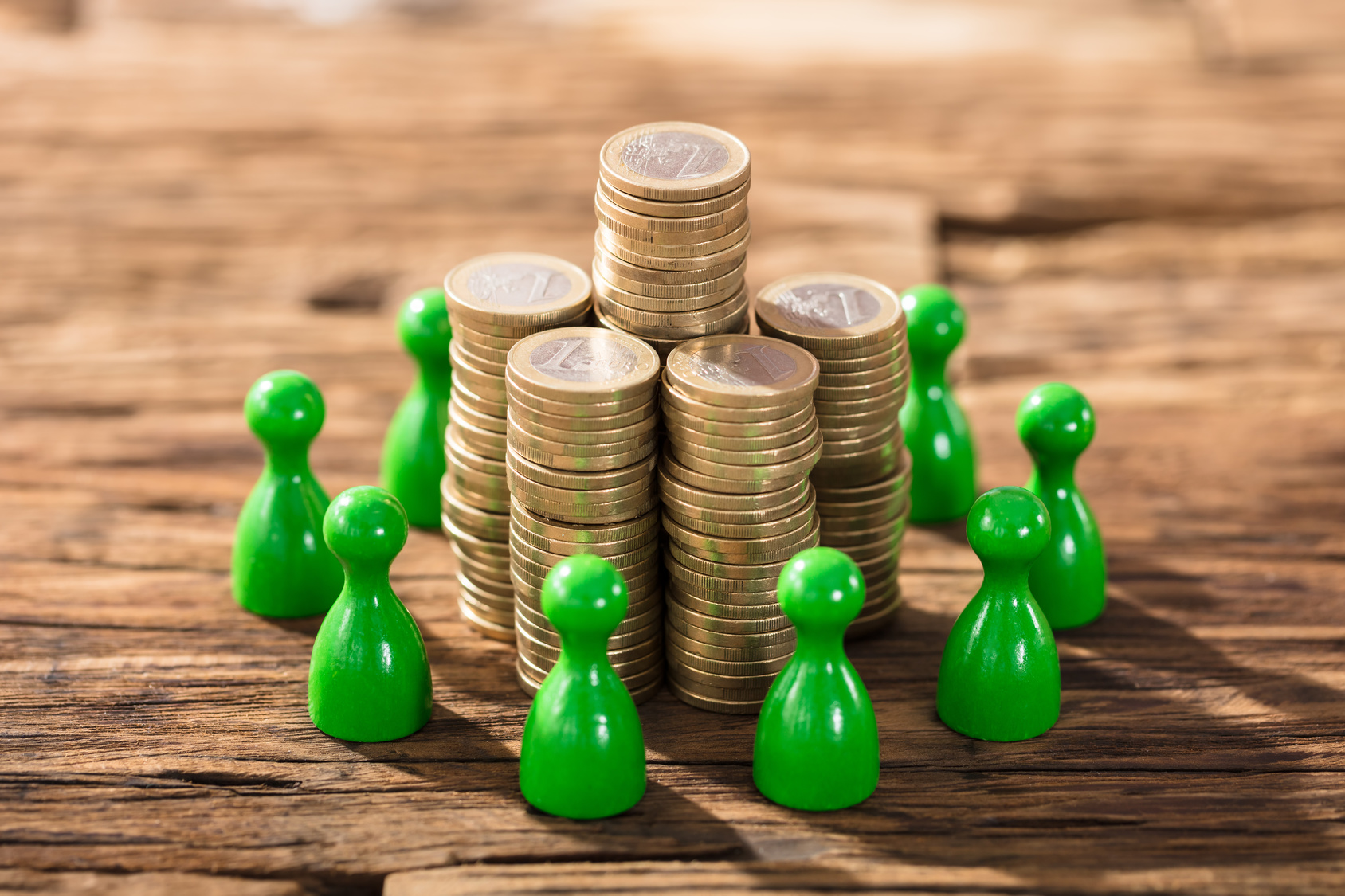 Stack Of Coins With Green Figures